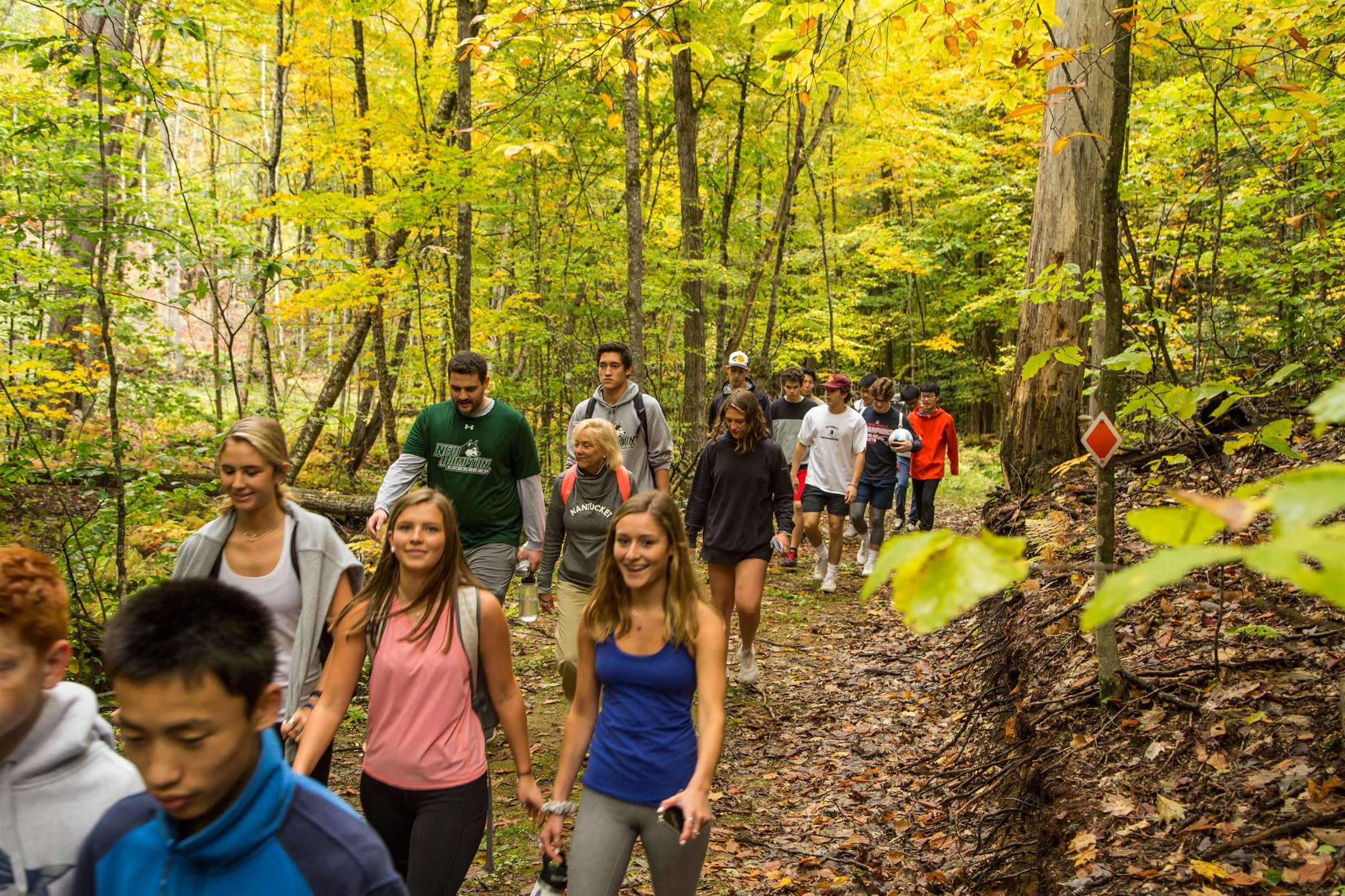 A group of students hike up New Hampton School's Burleigh Mountain