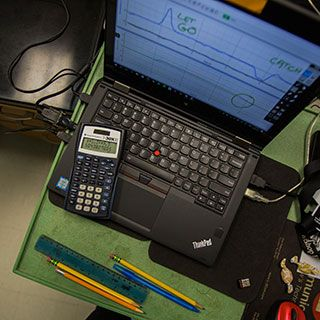 Laptops analyze data in physics lab