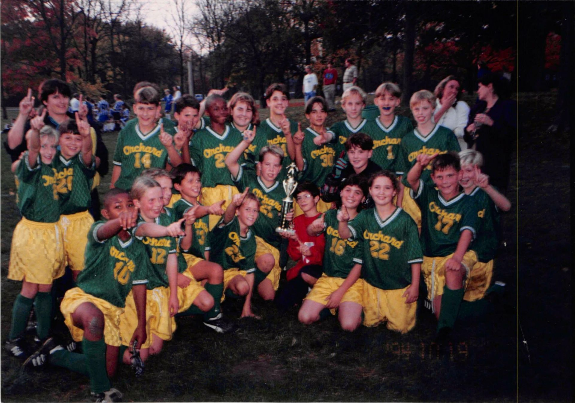 Chris (pictured top row, number 30) with his Orchard teammates after winning the IISL Soccer Championship.