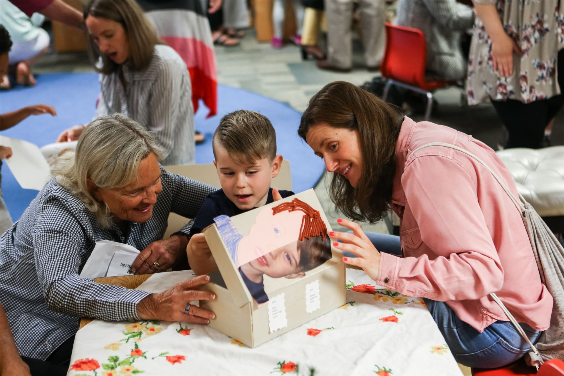 From identity boxes to tree guides and from interactive art stations to identity books, each classroom displays their work in a gallery for families to observe and discuss with their child. This end-of-the-year community event helps build the foundation for an Orchard education.