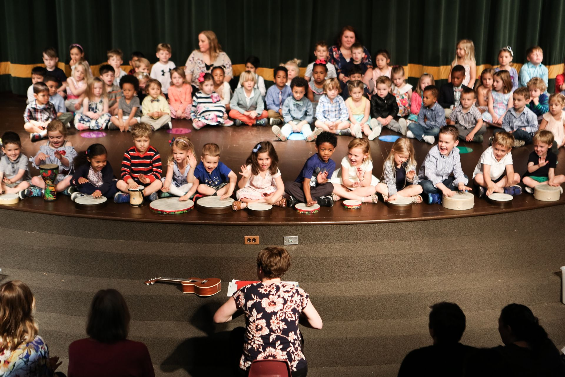 Preschool students perform confidently in front of 200 people in our theater. They debut special classroom songs, and popular childhood classics. They also play hand drums, rhythm sticks, and shaky eggs. These Owls even perform songs in Spanish. Pretty impressive for three, four and five-year olds!