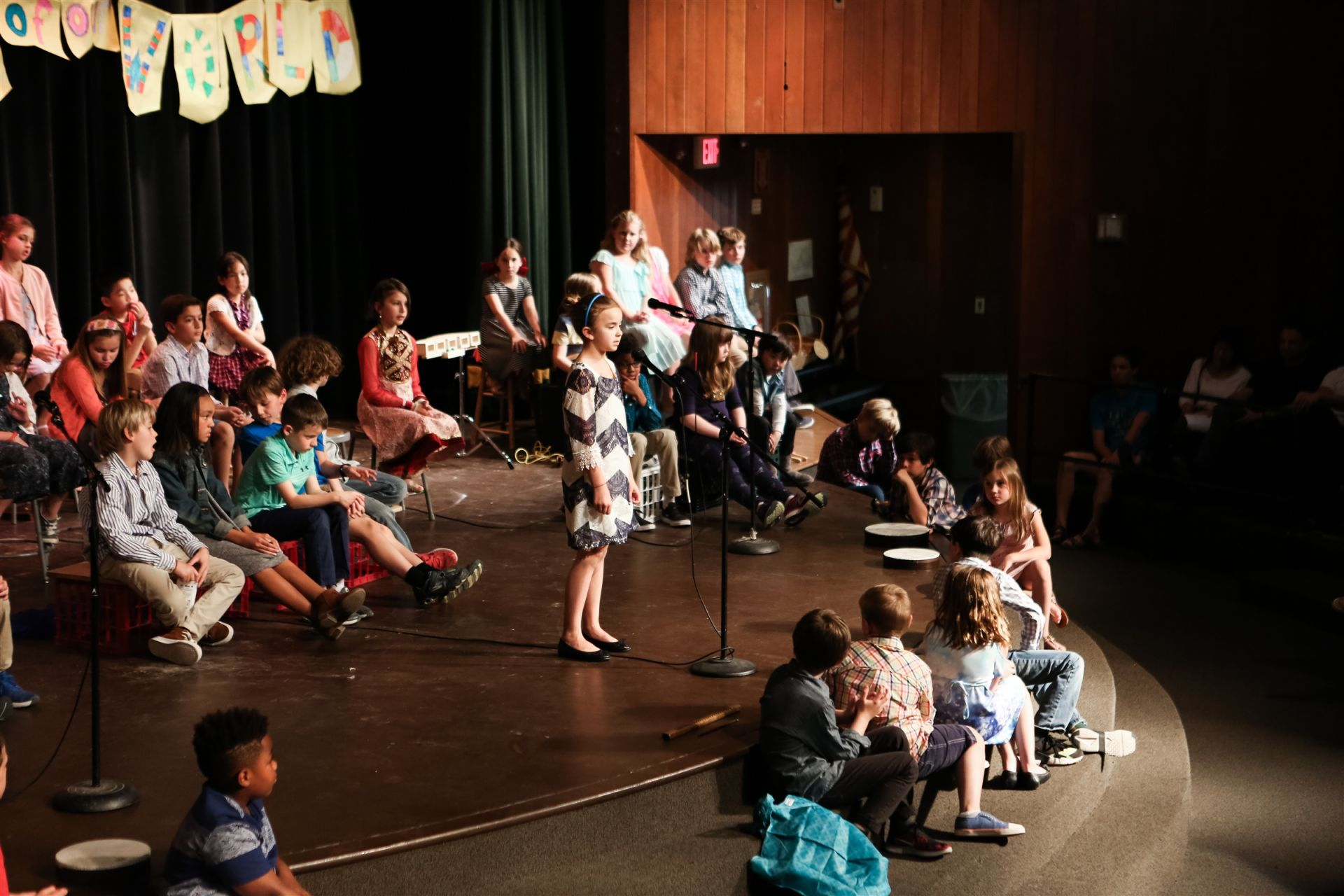 After studying poems, third grade students were encouraged not only to write their own, but also present them on stage! Starting in preschool, our teachers provide multiple opportunities for students to step out of their comfort zone in order to build confidence and showcase academic achievement. Welcome to Third Grade Poetry Night!