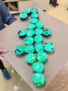 After learning that alligators are reptiles, they are born in eggs, and they start out tiny before getting bigger and bigger, students used math skills to measure and make alligator cupcakes. YUM!
