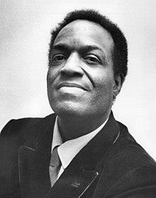 "Julius ""Nipsey"" Russell (1918 - 2005) was an American comedian, poet, and dancer. Mr. Russell served as a medic during World War II. He was one of the few African American soldiers to make the rank of captain during that era. He was best known for his appearances as a panelist on game shows from the 1960's through the 1990's, including ""Match Game,"" ""Password,"" ""Hollywood Squares,"" ""To Tell the Truth,"" and ""Pyramid."" He had one of the leading roles in the film version of The Wiz as the Tin Man. He was a frequent guest on the Dean Martin Celebrity Roast series. Nipsey Russell died of stomach cancer in 2005. He was not buried, but his ashes were spread across the Pacific Ocean."