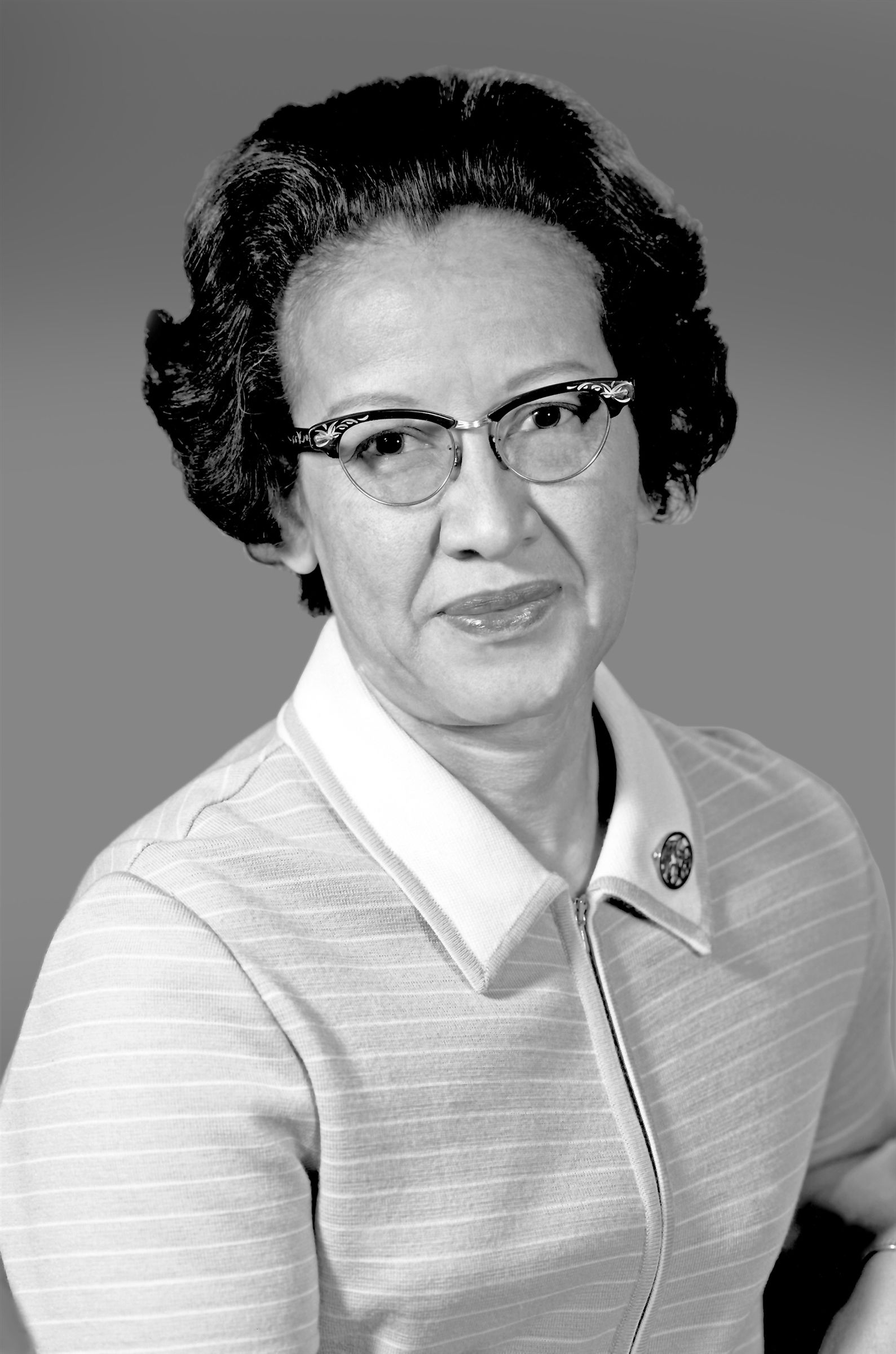 This is Katherine Johnson. She started high school at age 10 and went on to take every math class at West Virginia University. She graduated summa cum laude with degrees in mathematics and French at age 18. She applied to work at NASA and was first rejected, but she later started working there as a computer. While at NASA, she was one of few black women, yet she helped calculate orbital mechanics that helped with space flights. She is most known for helping with the mission of astronaut John Glenn, the first man to orbit the earth in 1962.   Katherine Johnson demonstrates that black women can work just as well (if not better than) their white coworkers. She broke barriers for both African Americans and women working in STEM. You may recognize her from the 2016 movie Hidden Figures, based on the book by Margot Lee Shetterly of the same name. There is a statue of her at her Alma Mater, West Virginia University, and there is even a Barbie doll of her. In 2015, President Barack Obama awarded her the Medal of Freedom, America's highest civilian honor. Today she is 100 years old and lives in Hampton, Virginia.