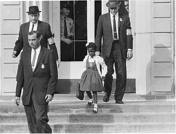Ruby Bridges was very brave when she was the first black student to go to an all-white school in New Orleans in 1960. We can't imagine how hard that would have been to face protesters every single day that yelled and threw things at Ruby. She had no friends to be with during lunch and recess. She never gave up and made a difference for all African Americans.