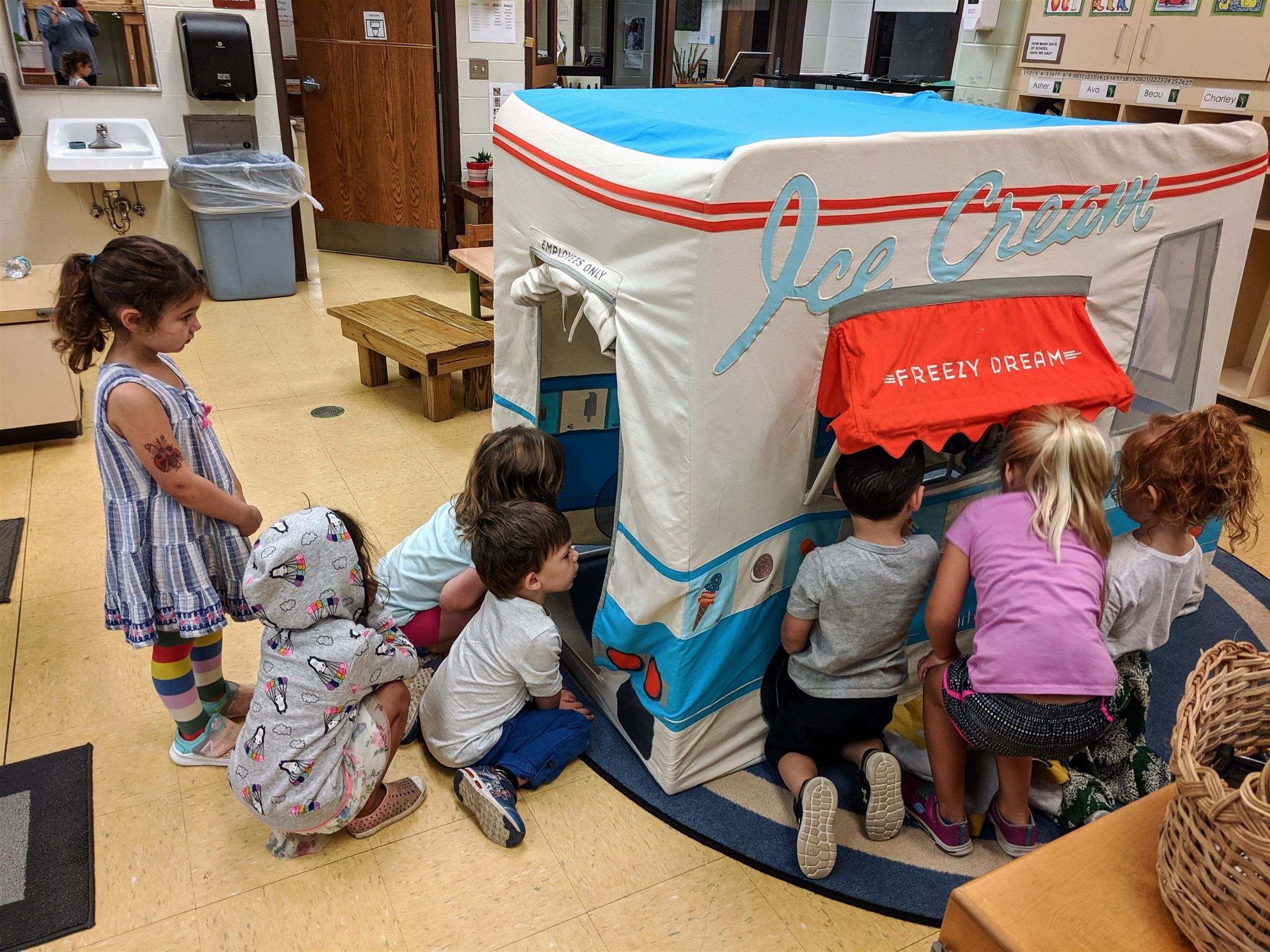 Students were using a wood-framed house like an ice cream shop during outdoor recess. This was a fun addition to add to the mix!