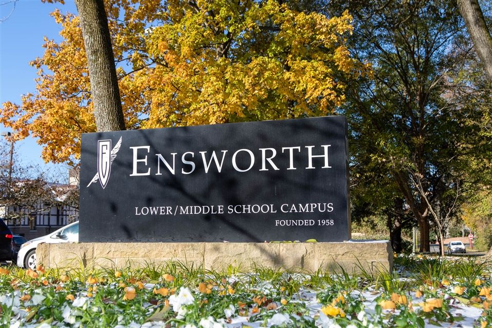 Ensworth sign with fall colors and snow