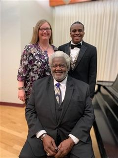 Pictured here are Travis Guillory, teacher Candy Coonfield, and operatic tenor and foundation patron Mr. Curtis Rayam.