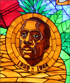Detail from a stained glass window featuring Howard Thurman at Howard University's Andrew Rankin Memorial Chapel.