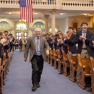 Math teacher Mark Howell '73 receiving a standing ovation on Charter Day last year.