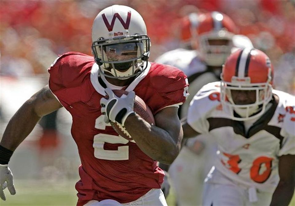 During Calhoun's 2005 season at Wisconsin, he became only the second player in Big Ten and NCAA history to finish with over 1,500 yards rushing and 500 yards receiving.