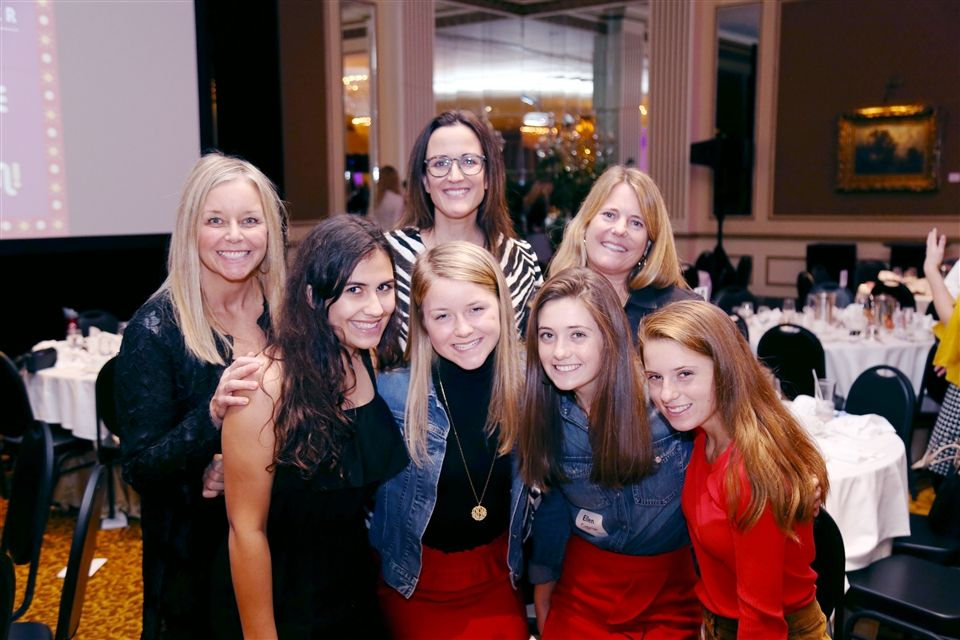 Katie Carney Dahm, DSHA '90, second row far left, attended the 2018 Mother Daughter event with her eldest daughter Delanie Dahm, DSHA '21, first row second from left. They spent the day with DSHA friends: Riley Halpern, DSHA '21, and her mother Emma Gillette, and the Cyganiaks – mother Ann; Ellen, DSHA '19, and Julia, DSHA '21.