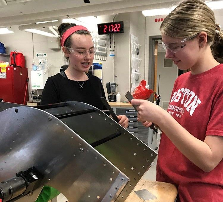 Ava Depies, DSHA '22 (left), and Isabella Nielsen, DSHA '22 (right), work together as members of the Hilltopper Robotics Team 1732.