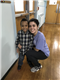 Kiomara Schaefer-Garcia, DSHA '18, poses with a student at Kagel Elementary of Milwaukee.