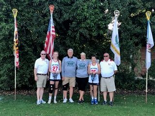 "Indian Creek Head Coach and Crosse Over Tour Director, Steve Willett, Molly Bunker, MetroGirls Lacrosse Directors, Tony & Michelle Malkin, Avery Barnhill '25and Indian Creek and Crosse Over Assistant Coach, Kevin ""Shecky"" Rose"