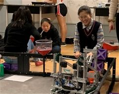 Jessica testing the team's robot