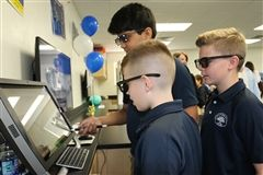 Declan Feeney '27, Zain Majeed '26, and Hayden Hornback '26 try out the new interactive Augmented Reality software.
