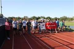 Participants walk the Survivor Lap to honor those fighting cancer.