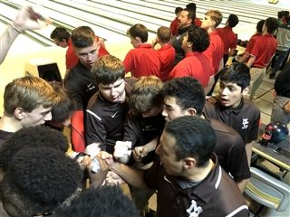 Varsity and junior varsity conduct a huddle prior to the start of the game.