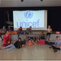 6th grade girls gave a presentation about UNICEF to the elementary at Morning Circle