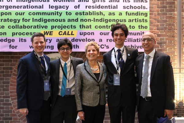 Model United Nations Club adviser Matt Griem, Ontario Model United Nations (OMUN) Conference co-secretary general Gaurav Dogra, MPP and former Ontario premier Kathleen Wynne, OMUN Conference co-secretary general Shaan Hooey, and Upper School head Naheed Bardai.