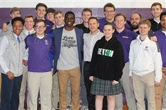 Chris Singleton poses with students and administrators from Elder, Seton, and St. Xavier high schools.