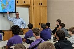 Steve Driehaus '84 presents to a World History class