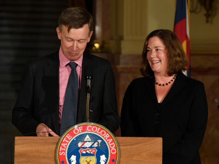 Colorado Gov. John Hickenlooper announces Melissa Hart, right, for his pick for the vacant Colorado Supreme Court Justice seat at the Colorado State Capitol Dec. 14, 2017.