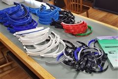 The face shields consist of a padded double-headband, clear film and bottom reinforcements.