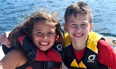 2 young campers in life jackets
