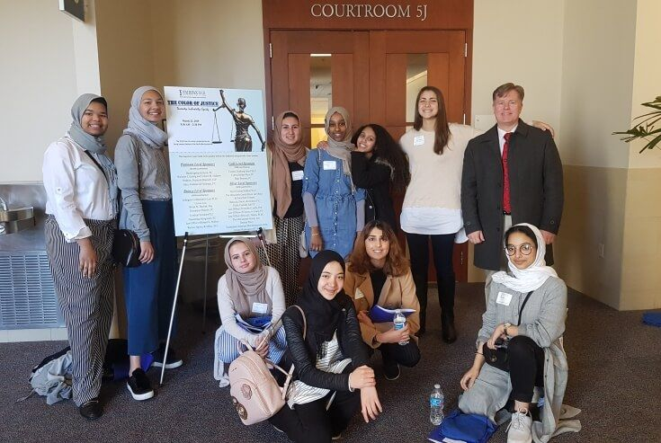 Standing from left to right: Sarah Rajab, Stephanie Rajab, Jannah Hagar, Rania Ali, Danya Negash, Sereen Haddad, and Mr. Sarver. Seated from left to right: Hana Sarver, Asena Semseddin, Neha Malik, and Rasil Alamry.