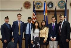 From left to right, Tony Sarver (Master of Ceremonies), Aidan Todorov, Surya Reddy, Jena Musmar, Rosy Sultana, Finn Marks, and Bob Molepske (Post Commander)