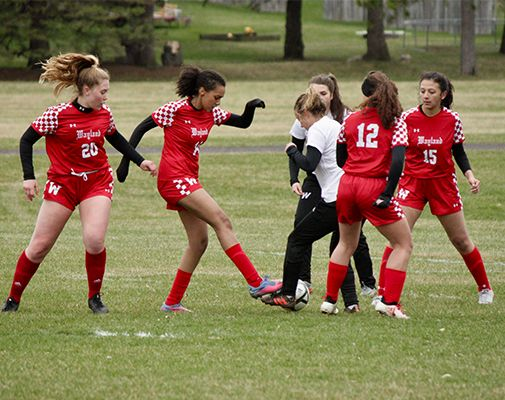 Wayland Girls Soccer persevered through drizzle to a strong finish.