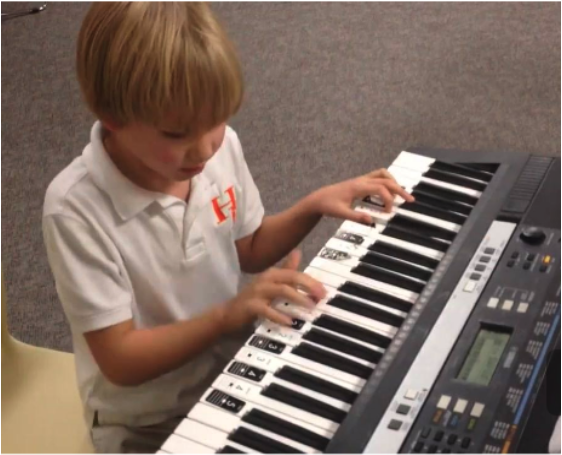 iPiano Student Playing a Keyboard