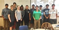 Jules Oppenheim '15 (Bright green shirt) with IRP students.