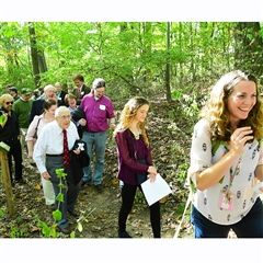 Tesssa Johnson leading the Walk in the Woods with Art King in white shirt and tie.