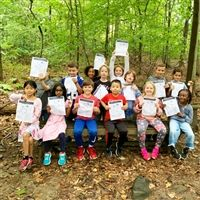 Hackley Lower School students set off into the woods  equipped with Hackley Trail maps and compasses