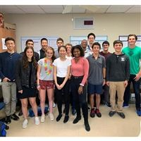 Kiegan Lenihan '15 (Far right in green shirt.) returned to the Hilltop to speak to the IRP students about his research experiences at Duke University.