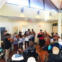 The students performing a variety of pieces for the residents.