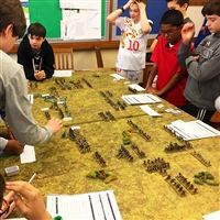 Middle School students develop their game strategies on a Saturday morning.