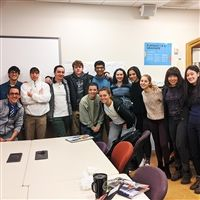 English 12 class celebrated Thomas Tung-Yep (4th from left) with treats and well-wishes.