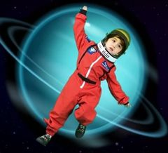 A Clairbourn preschool student floats in space in front of the planet Mercury using green screen movie magic.