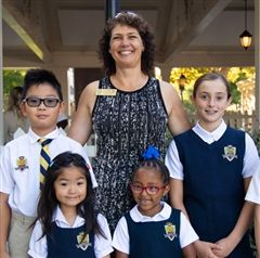 Head of School Dr. Amy Patzlaff with Clairbourn students from the Fall of 2019