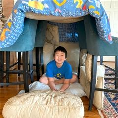 Students used pillows, blankets, and furniture from their homes to build pillow forts that met the requirements for the challenge.