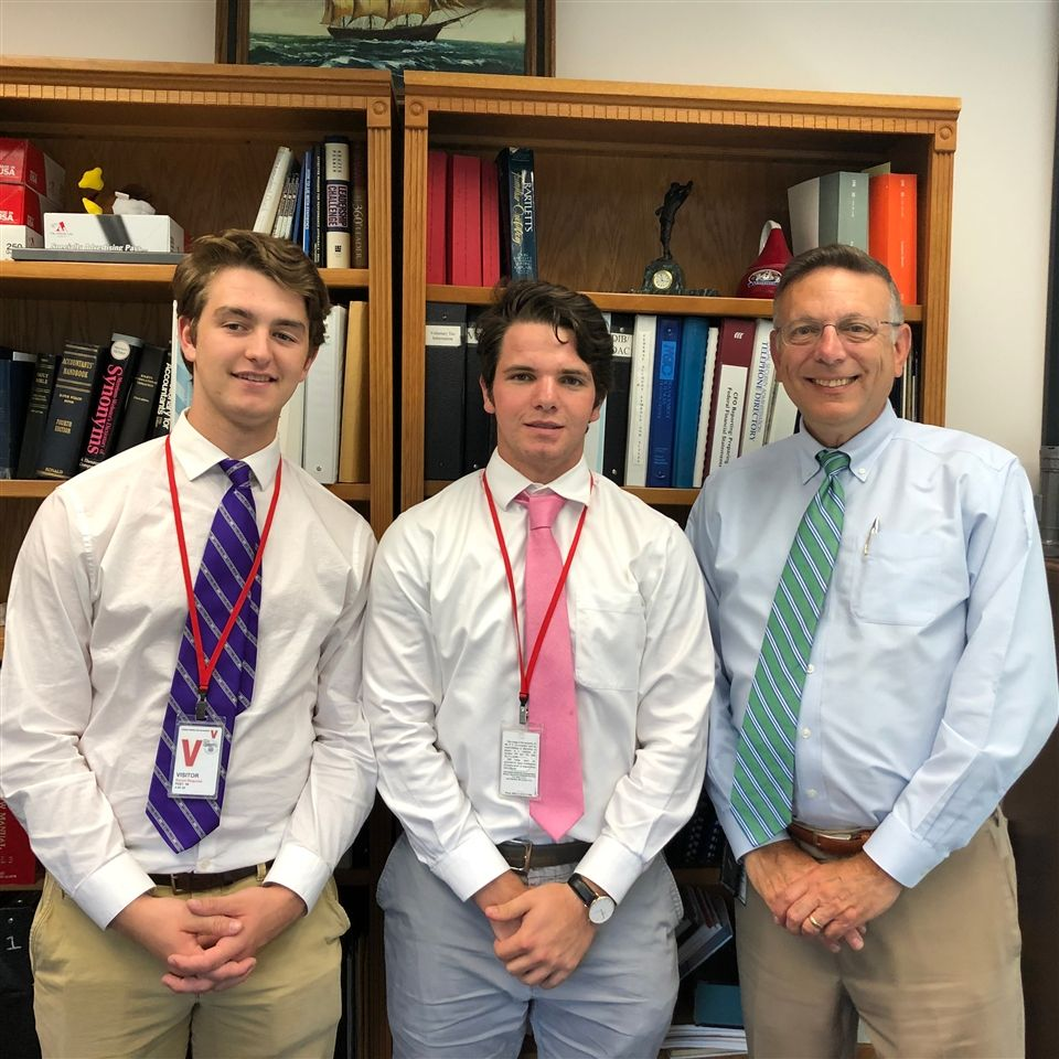 James DeMaria '20 and Gannon Berry '20 complete their externship with Mark Silvestri, parent of a 2013 graduate, at the Social Security Administration.