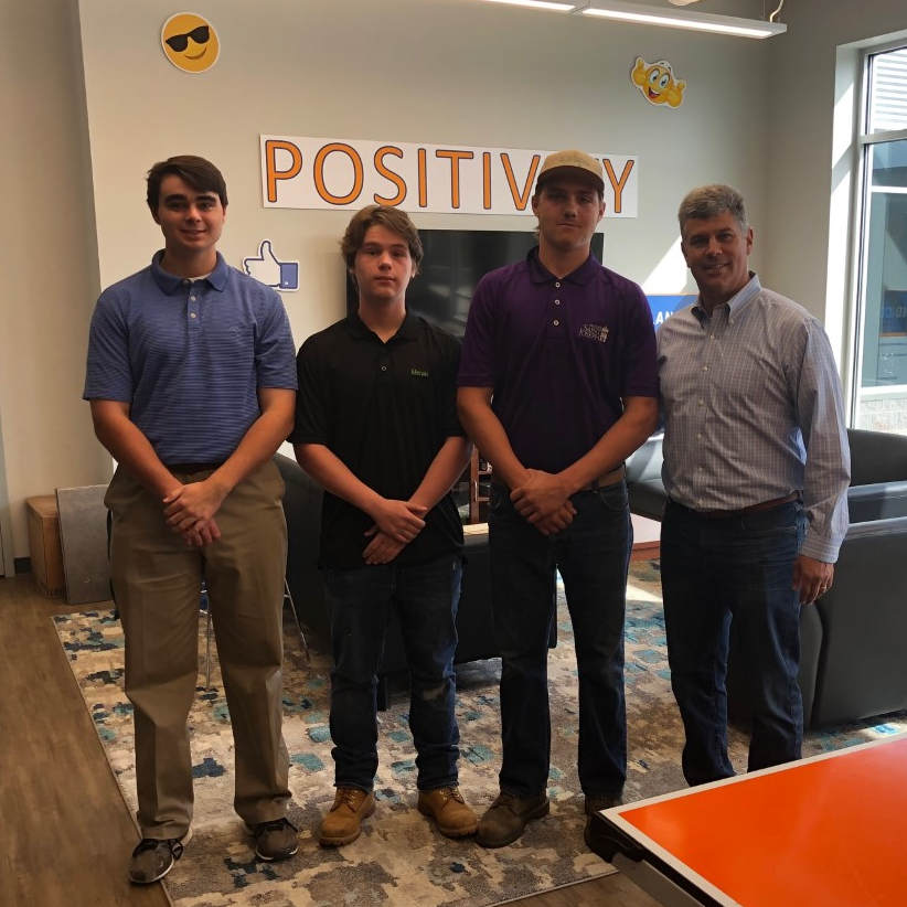 Colton Burger '20, Andrew Gray '20, and Grant Kline '20 at their externship with Brett Plano '89 of Plano-Coudon, LLC.