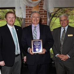 Pictured here with Alumni Association President Matt Hall '03 and MSJ President George Andrews, the 2018 Alumnus of the Year Michael Hinkey