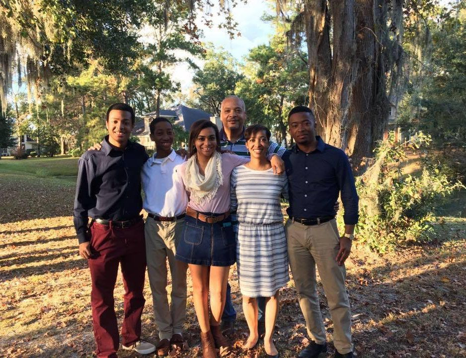 Mrs. Ursula Wright, second from the right, poses for a photograph with her family. Featured with her are (left-to-right) son, Nigel Wright (BC '14), Nathan Wright, Nadia Wright (SVA '16), and Nick Wright (BC '10). Her husband, Mr. Craig Wright, is in the back. Photo courtesy of Mrs. Ursula Wright.