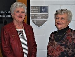 Mary Ann McCarthy Miller, left, and Elizabeth Linden McCarthy Lynn stand in front of Benedictine Military School's Lt. Commander Daniel J. McCarthy, M.D., '26 technology laboratory, which was dedicated Feb. 21, 2020, in honor of their father, who was killed in action at the Battle of Iwo Jima on Feb. 22, 1945.
